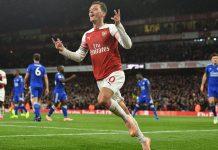 Andrew Cole Angkat Bicara Terkait Status Ozil di Arsenal