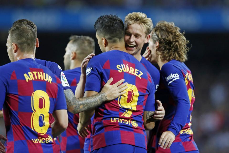Brace Suarez Bawa Barcelona Menang 5-2 Atas Valencia