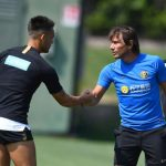 Lautaro Martinez hugs Antonio Conte